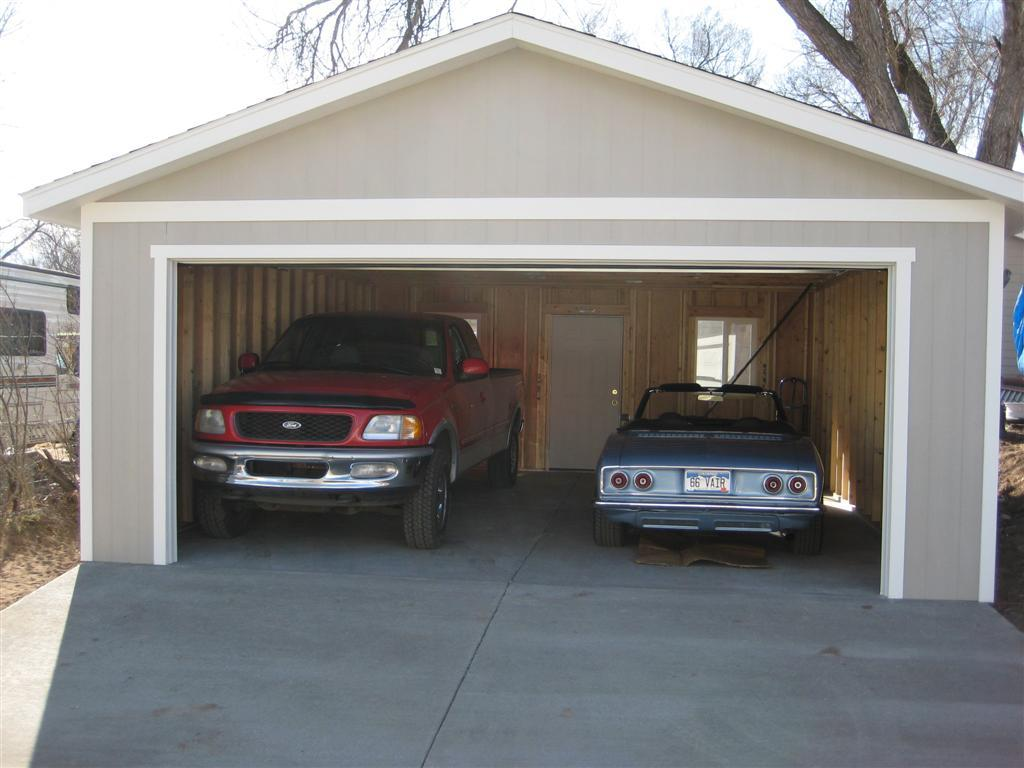 What 39 s a wood garage cost to build for Cost to build rv garage